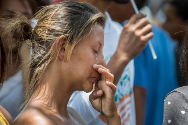 A group of prisoners' relatives react outside a detention center in Valencia, Venezuela, where a fire started Wednesday. Photo by Miguel Gutiérrez/EPA-EFE