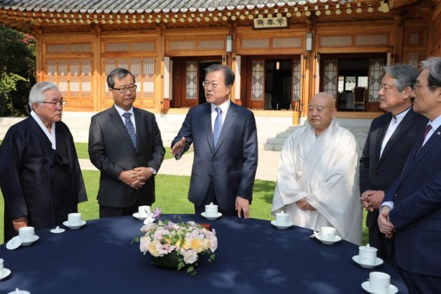 South Korean President Moon Jae-in (4-R) speaks with the leaders of the country's seven largest religions prior to a luncheon meeting at the presidential office in Seoul on Monday. Photo by Yonhap/EPA-EFE