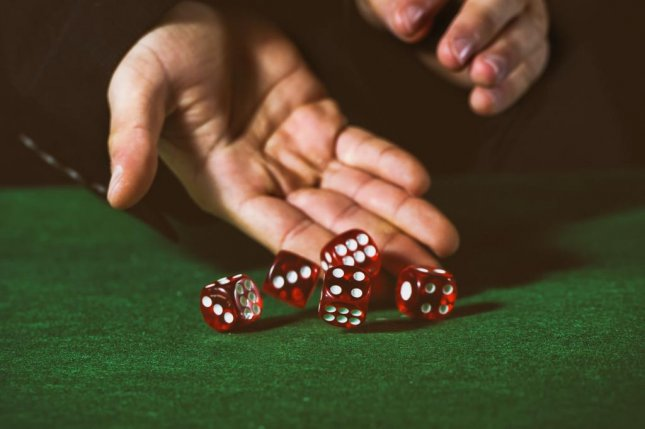 Winners of an estimation game were more likely to cheat in a subsequent dice game. Photo by Kiko Jimenez/Shutterstock