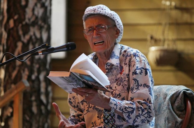 Russian poet Yevgeny Yevtushenko reads his work during the annual event 'Bulatovskie Reads' in Moscow in 2011. Yevtushenko, who is considered one of the best known poets of the 1950s and 1960s in the Soviet Union, died Saturday at 84. Photo be Sergei Ilnistky/EPA