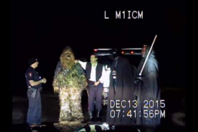 A Fulshear Police Department officer speaks with Star Wars characters after asking them to exit their vehicle. Fulshear Police/Facebook