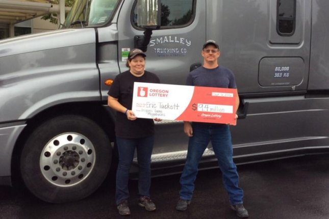 Truck driver Eric Tackett and his wife, Bethany, stopped to make a delivery on their way to claim a $9.4 million Megabucks jackpot. Photo courtesy of the Oregon State Lottery