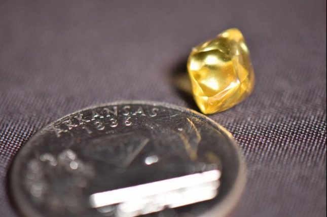 Steven McCool of Fayetteville, Ark., found a4.49-carat sparkling, canary yellow diamond during his recent trip to Crater of Diamonds State Park. The discovery was the third-largest diamond found at the park so far this year. Photo courtesy of Arkansas State Parks