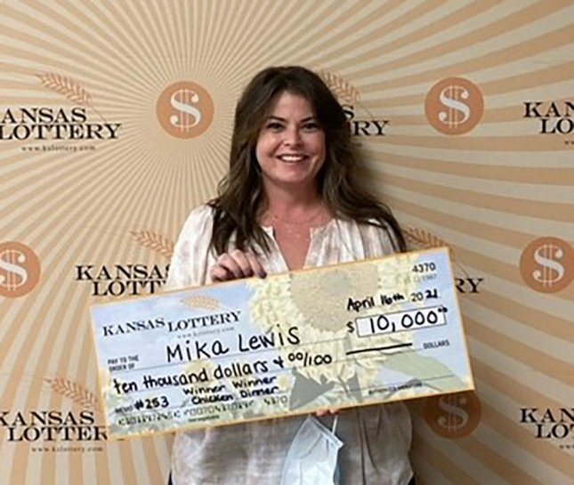 Mika Lewis told Kansas Lottery officials she arrived early for an appointment to have her vehicle tires changed, so she stopped into a store and bought a scratch-off lottery ticket that earned her a $10,000 jackpot. Photo courtesy of the Kansas Lottery
