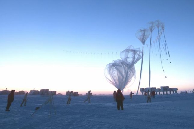 NOAA scientists stationed near the South Pole regularly deploy high altitude weather balloons to measure the vertical dimensions of the ozone layer, or the lack there of. Photo by NOAA
