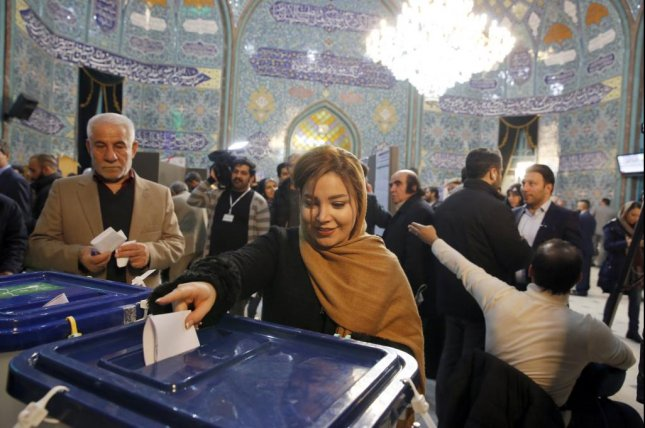 An Iranian woman casts her ballot at a polling station during the parliamentary elections in Tehran on Friday. Early returns show conservatives gaining a majority of seats in the country's Parliament. Photo by Abedin Taherkenareh/EPA-EFE