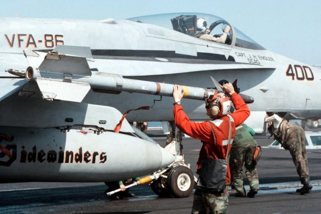 An AIM-9X Sidewinder missile is loaded onto a U.S. Navy aircraft. South Korea is seeking to buy the weapon. (DoD photo by Petty Officer 3rd Class Brian Fleske, U.S. Navy)