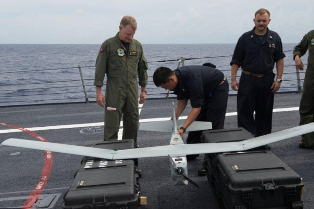 Quartermaster 3rd Class N. Wylie launches PUMA II, a small unmanned aircraft system aboard the Arleigh Burke-class guided-missile destroyer USS Gonzalez. U.S. Navy Photo by Mass Communications Specialist 2nd Class D. C. Ortega