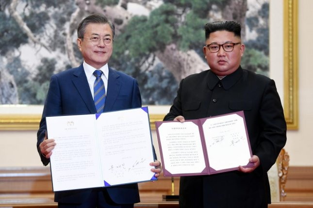 South Korean President Moon Jae-in and North Korean leader Kim Jong Un pose for a photo after signing the joint declaration at their third summit in Pyongyang, North Korea, on Wednesday. Photo by Pyongyang Press Corps