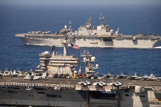 Strike groups led by the USS Theodore Roosevelt, foreground, and USS America met for exercises last week in the Pacific Ocean, the U.S. Navy announced. Photo by MCS2 Anthony Rivera/U.S. Navy/UPI