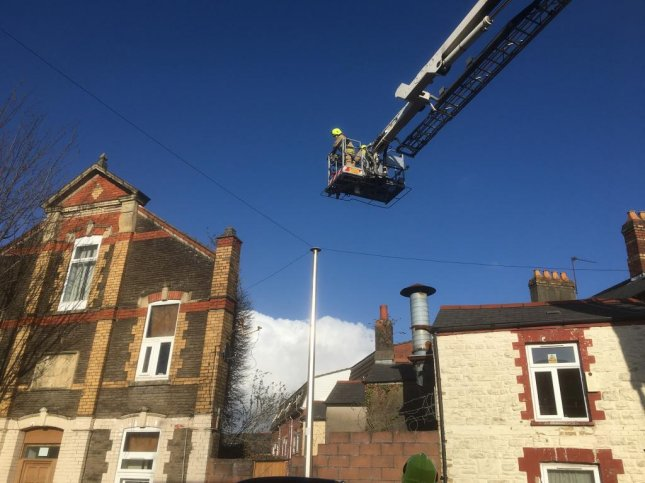 An RSPCA animal rescuer summoned the South Wales Fire & Rescue Service when a cat was found stranded on the roof of a three-story building in Cardiff. The cat was reunited with his owner. Photo courtesy of RSPCA Cymru