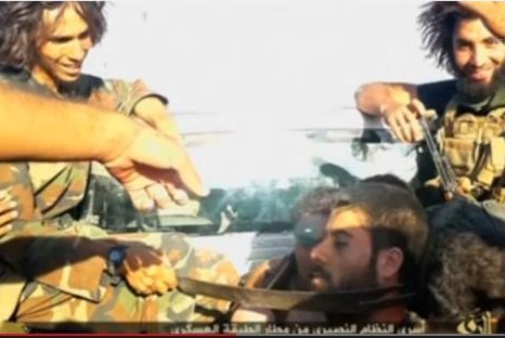A screenshot from a video purportedly showing Islamic State militants threatening Syrian soldiers from an airbase in Raqqa Province, Syria, before their execution. (YouTube)