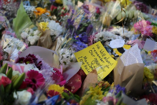 Flowers left by people as they pay their respects in St. Annes Square on the anniversary of the Manchester Arena bombing in 2018. Hashem Abedi on Tuesday pleaded not guilty to 22 counts of murder in connection with the incident. Photo by Nigel Roddis/EPA-EFE