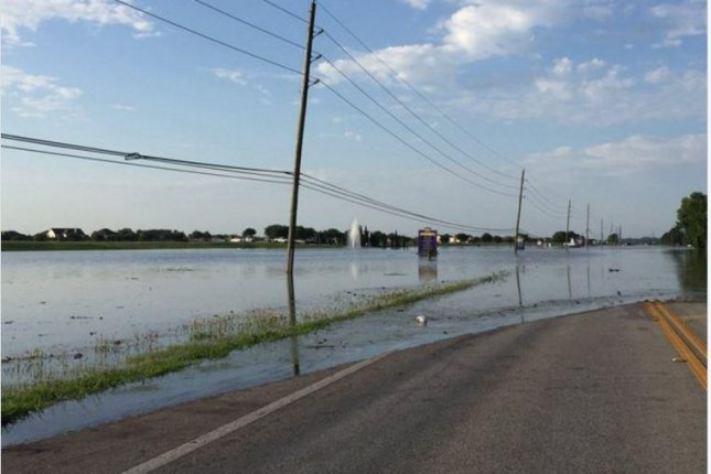 Water overflows the Brazos River onto a road in the Kingdom Heights subdivision in Rosenberg, Texas. The Fort Bend County Sheriff's Office reported that the subdivision was surrounded by water with no way in or out. Photo courtesy of Fort Bend Sheriff's Office/Twitter