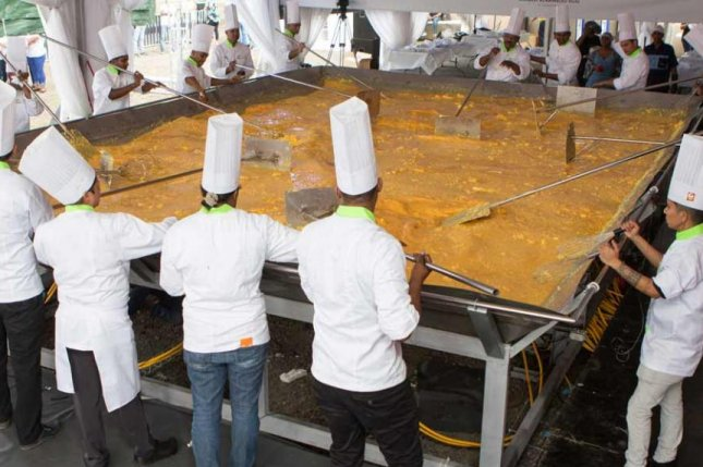 A nearly 5,500-pound batch of scrambled eggs cooked up by a team of chefs in Mauritius was certified as the world's largest. Photo courtesy of Guinness World Records
