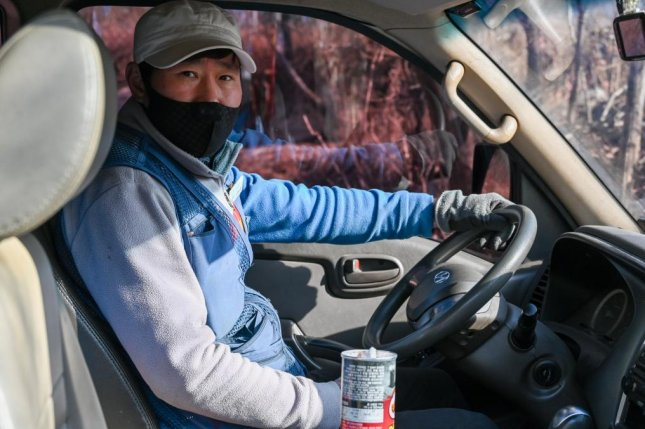 Kim Do-gyun is one of the more than 50,000 delivery drivers working grueling hours as shipments skyrocket during the COVID-19 pandemic. Photo by Thomas Maresca/UPI