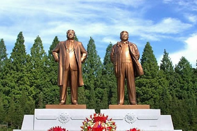 Father-son statues of North Korean leaders Kim Il Sung and son Kim Jong Il are also altars of veneration in North Korea. Photo by KCNA/Yonhap