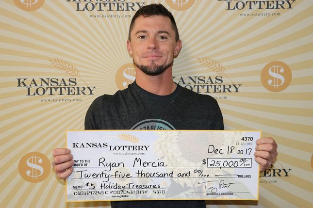 Look: Man credits lotto win to luck from birth of first
