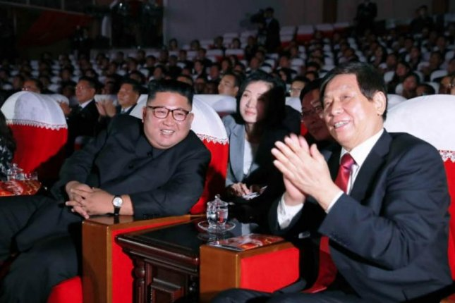 Kim Jong Un (L) and Li Zhanshu (R) chairman of the National People's Congress, attend a concert in Pyongyang held to strengthen bilateral ties. Photo by Rodong Sinmun