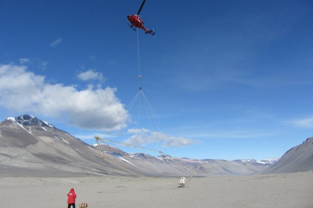The sensor system was hung from a helicopter and flown over the deserts of Antarctica. Photo by the University of Tennessee