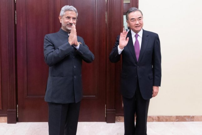 Chinese foreign minister Wang Yi (R) is pictured with Indian foreign minister Subrahmanyam Jaishankar Thursday at the Shanghai Cooperation Organization summit in Moscow, Russia. Photo by Bai Xueqi/Xinhua/EPA-EFE
