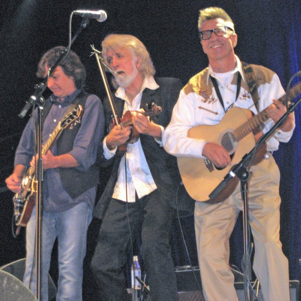 Pete Anderson (R) is one of several seminal figures in the rise of rock 'n' roll behind the Iron Curtain who are at the center of Rockin' the Kremlin, a feature documentary currently in production. Also pictured are members of the Nitty Gritty Dirt Band Jeff Hanna (L) and John McEuen (C) during a performance in Seijord, Norway. (Courtesy Douglas A. Yeager Productions Ltd.)