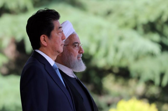Iranian President Hassan Rouhani (R) welcomes Japanese Prime Minister Shinzo Abe (L) at Saad Abad Palace in Tehran, Iran, on Wednesday, a day before two oil tankers in the Gulf of Oman were attacked. File Photo by Abedin Taherkenareh/EpA-EFE