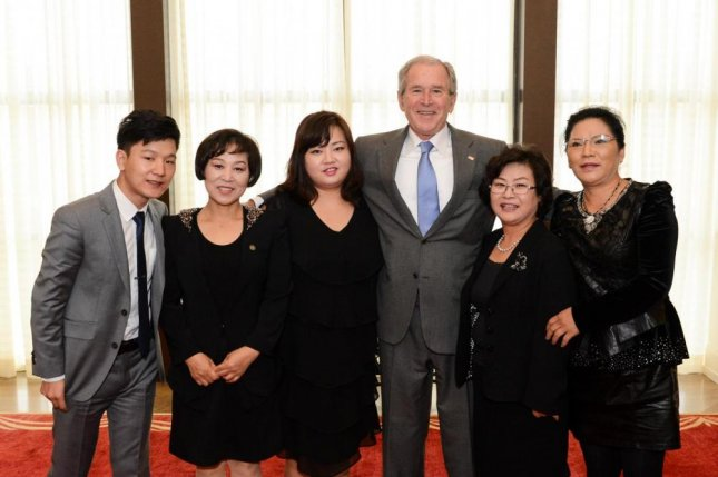 North Korean defector Cho Jin-hye (3rd-L), meeting with former President George W. Bush in 2008. Cho says she has fought off rumors about her identity for nine years. Photo courtesy of Cho Jin-hye/Facebook