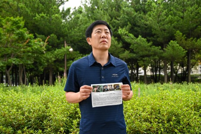 Defector Park Sang-hak, who heads the group Fighters for a Free North Korea, holds one of the flyers he sends by balloon into the North. Photo by Thomas Maresca/UPI