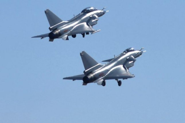 J-10 fighter aircraft of China, similar to those pictured in early January, were among 15 warplanes flying through Taiwan's airspace over the weekend. Photo courtesy of People's Republic of China Defense Ministry