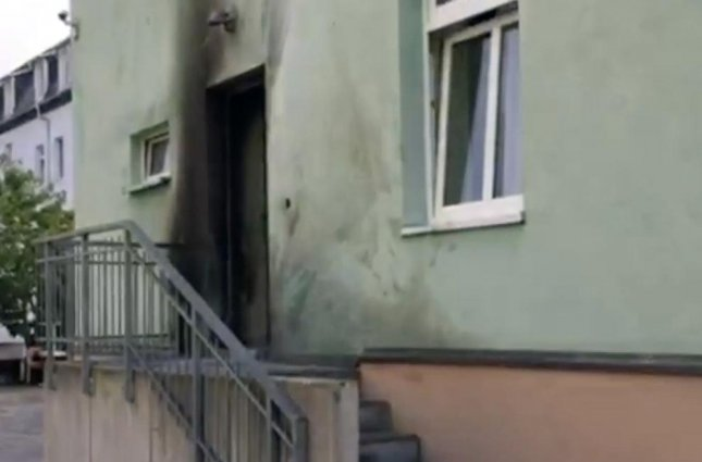 The door of a Dresden, Germany, mosque shows indications of a homemade explosive Monday. A similar explosive device detonated at the city's convention center. Screenshot from YouTube