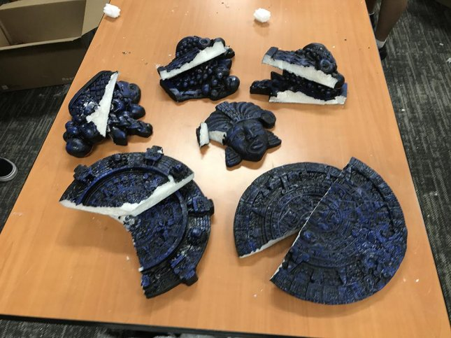 Federal investigators said eight people were arrested in connection with an alleged plot to ship meth disguised as Aztec calendars and decorative statues from California to Hawaii. Photo courtesy of U.S. Immigration and Customs Enforcement