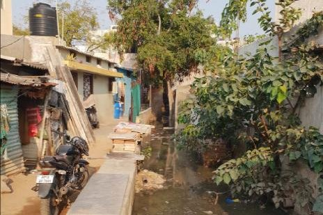 Untreated waste water is pictured flowing by settlements on the outskirts of Hyderabad, India. Photo by Dishaad Bundhoo