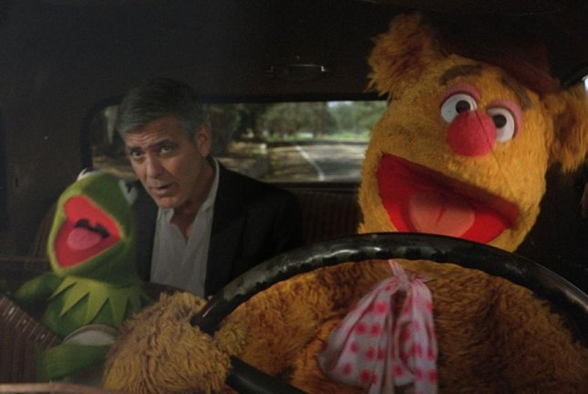 "George Clooney gets a lift from Kermit the Frog and Fozzie Bear in the new Nespresso ""Comin' Home"" advertising campaign. Photo courtesy of Nespresso"