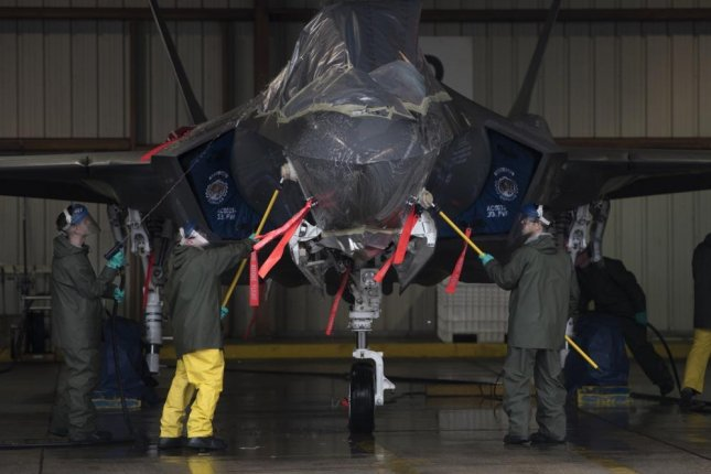 U.S. Air Force Col. Paul D. Moga, 33rd Fighter Wing commander, and Airmen from the 33rd Aircraft Maintenance Squadron clean an F-35A Lightning II at Eglin Air Force Base, Fla. Photo by Staff Sgt. Peter Thompson/U.S. Air Force.