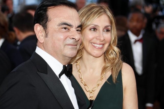 Former Nissan Chairman Carlos Ghosn (L) and his wife, Carole Ghosn, are being sought by prosecutors in Japan. File Photo by Ian Langsdon/EPA