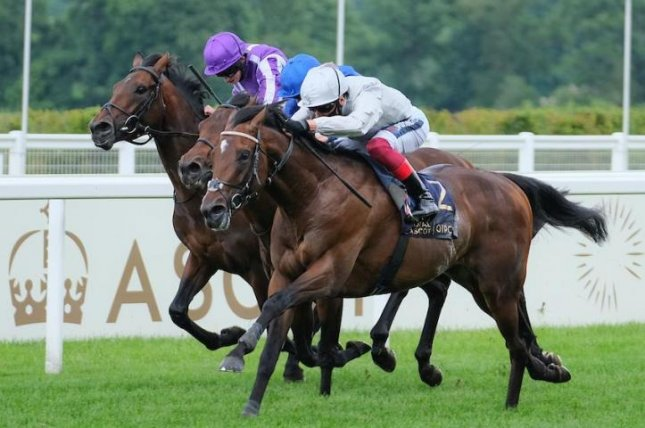 Palace Pier (silver colors) gives Frankie Dettori his third win of the day at Royal Ascot, taking Saturday's Group 1 St James's Palace Stakes. Photo courtesy of Ascot Racecourse