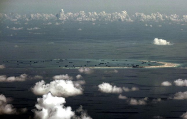 China is allegedly building islands, including the ones pictured on May 11, 2015, in the South China Sea in disputed waters and is constructing military bases on them. The commander of U.S. forces in the Pacific sought to reassure allies in the region the United States stands ready to step in and stop China's aggressive moves there, announcing the U.S. plans to station F-22 Raptor fighter jets in Northern Australia as part of its plan for deterrence. Photo by Ritchie B. Tongo/Pool/European Pressphoto Agency