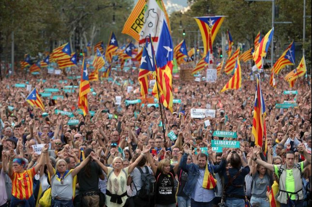 Roughly 450,000 pro-independence protestors came out in Barcelona in support of Catalonia's autonomy. Photo by Toni Albir/EPA