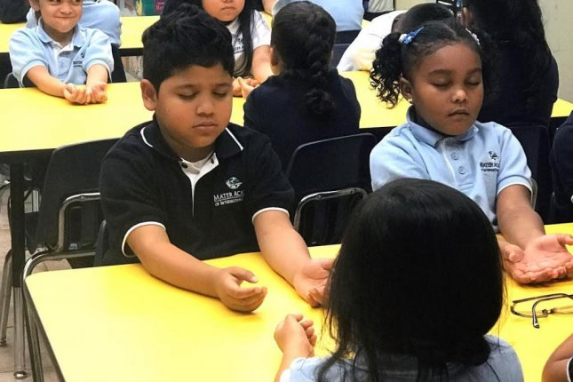 Inner Explorer's program includes daily 5- to 10-minutes audio-guided mindfulness practices designed to help children develop the capacity to sustain focus and to do better in school.Photo courtesy of Inner Explorer