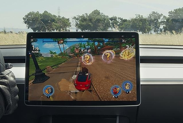 Tesla will launch a new downloadable video game, Beach Buggy Racing 2, Tuesday that will use the actual steering wheel and brake pedal when the vehicle is in park. Photo from Tesla/Tesa.com