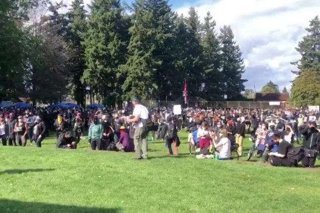 Hundreds of people gather at Peninsula Park Saturday afternoon in Portland at a counter-demonstration to a Proud Boy rally the same day. Image courtesy of KGW/Twitter