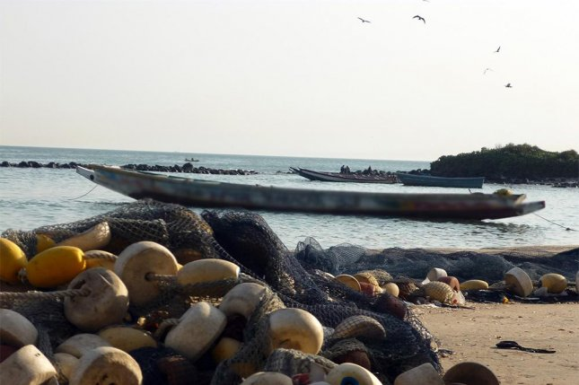 A vessel sits off the coast of Senegal. On Saturday another vessel caught fire and capsized, killing 140 people. File Photo courtesy of the IOM