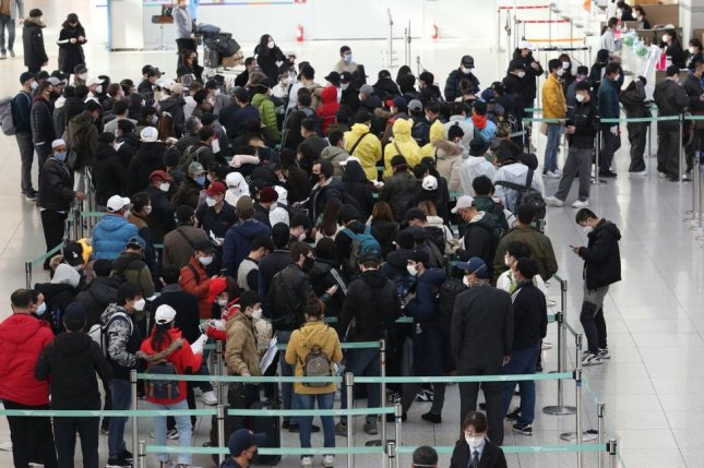Foreigners staying illegally in South Korea wait to report their voluntary departure at an immigration office at Incheon International Airport in South Korea in March. File Photo by Yonhap/EPA-EFE