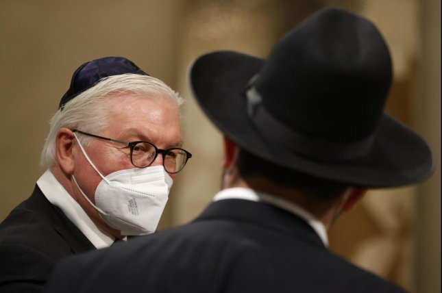 German President Frank-Walter Steinmeier (L) speaks with a rabbi following a ceremony on the 76th anniversary of the liberation of Nazi Germany's Auschwitz death camp on International Holocaust Remembrance Day Wednesday in Berlin. Photo by Odd Andersen/EPA-EFE