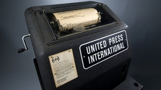 A vintage UPI teletype. Machines like it were used to transmit not only news but message traffic between bureaus in a shorthand language known as cablese, a predecessor to texting. (courtesy downhold.org)