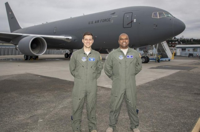 Nick Cenci, Major, U.S. Air Force Chief of Flight Operations DCMA (left), and Anthony Mariapain, Major, U.S. Air Force KC-46 Chief Pilot DCMA, stand in front of a KC-46A that was accepted by the U.S. Air Force. Photo courtesy of the U.S. Air Force