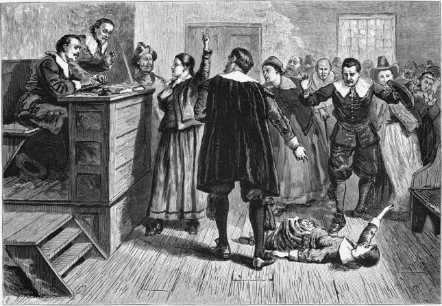 An engraving from an 1876 history book purports to show the 1962 Salem, Mass., witchcraft trials. Historians recently determined the site of the hangings of 19 of those accused of witchcraft. Anonymous engraving/Wikipedia