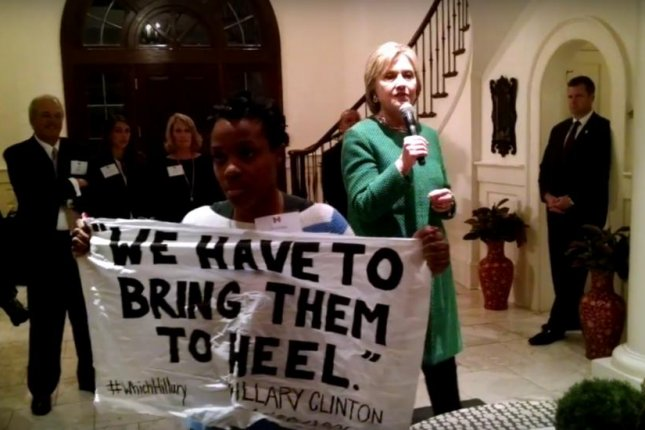 Protester confronts Clinton, demands apology for mass incarceration