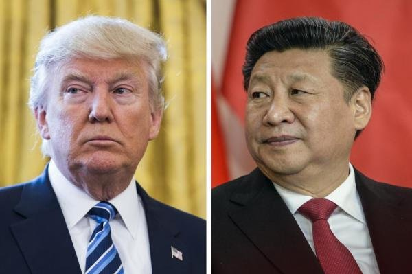 U.S. President Donald Trump and Chinese President Xi Jinping agreed China should be allowed a grace period before it takes action against domestic firms enabling North Korea. File Photo courtesy of Jim Lo Scalzo/Filip Singer/EPA